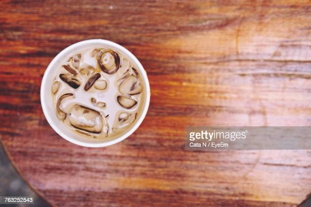 Directly Above Shot Of Cold Coffee On Wooden Table