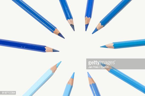 directly above shot of colored pencils against white background - color pencil stock pictures, royalty-free photos & images
