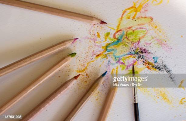 Directly Above Shot Of Colored Pencils And Paintbrush On White Table
