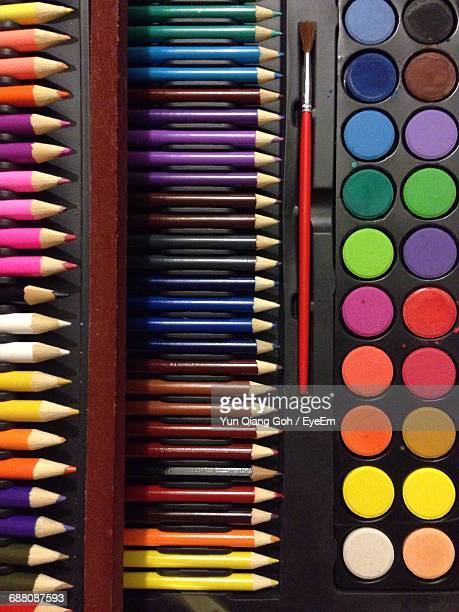 Directly Above Shot Of Colored Pencils And Watercolor Palette