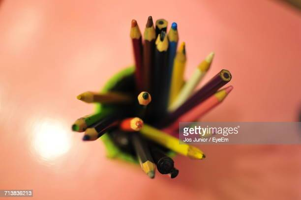 Directly Above Shot Of Colored Pencils In Desk Organizer On Table