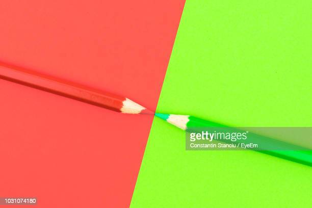 directly above shot of colored pencils on table - two tone color stock pictures, royalty-free photos & images