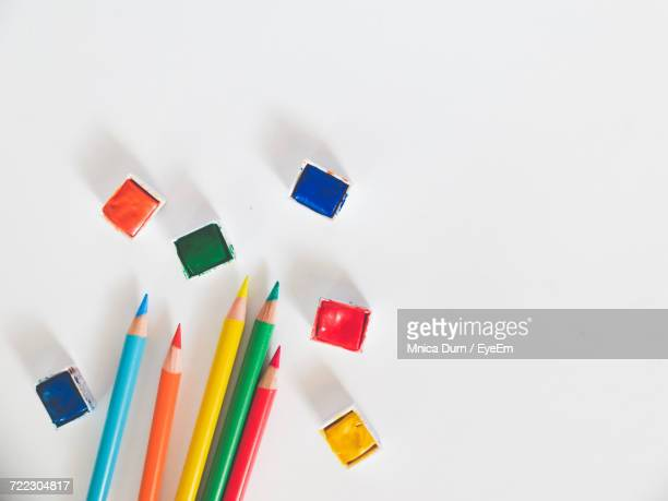 Directly Above Shot Of Colored Pencils With Colors On White Background