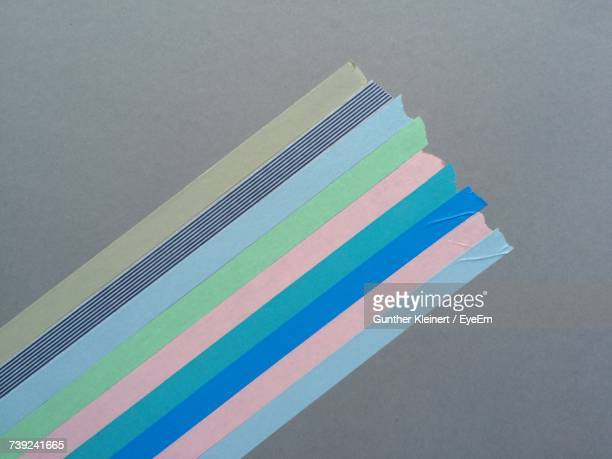 Directly Above Shot Of Colorful Adhesive Tapes On Gray Table