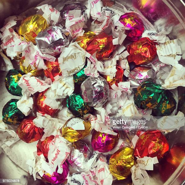 directly above shot of colorful candies in container - candy wrapper stock photos and pictures