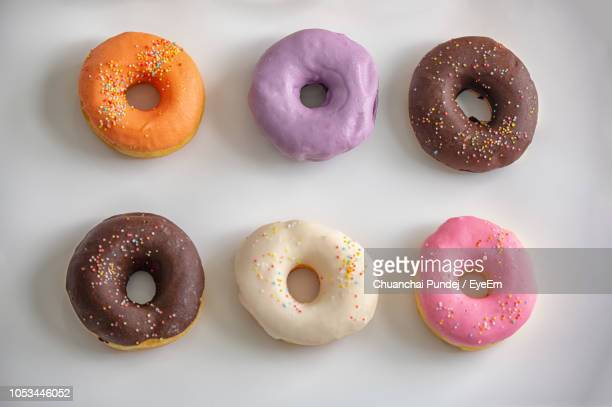 Directly Above Shot Of Colorful Donuts On White Background