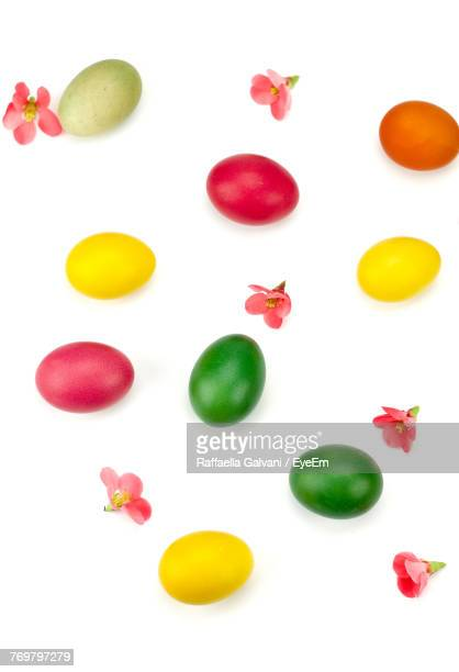 Directly Above Shot Of Colorful Easter Eggs On White Background