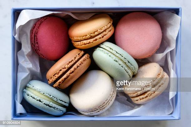 Directly Above Shot Of Colorful Macaroons In Container