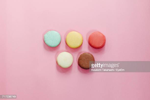 Directly Above Shot Of Colorful Macaroons On Pink Table