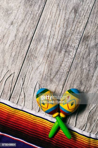 directly above shot of colorful maraca on wooden table - maraca stock photos and pictures