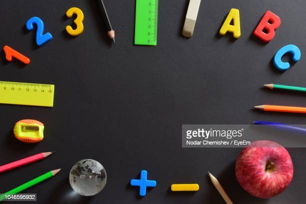 directly above shot of colorful objects on table - ものさし ストックフォトと画像