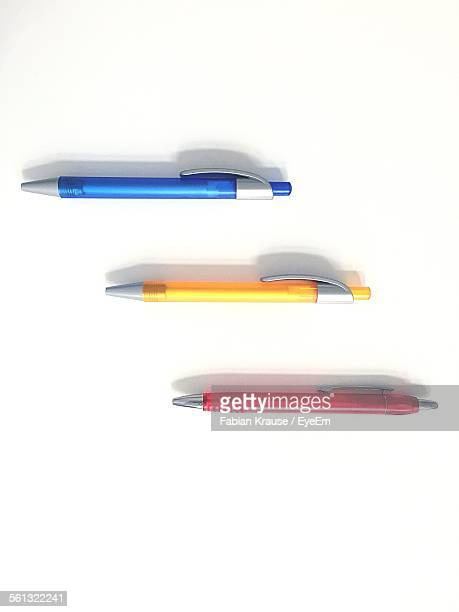 Directly Above Shot Of Colorful Pens On White Background