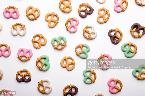 Directly Above Shot Of Colorful Pretzels On White Background