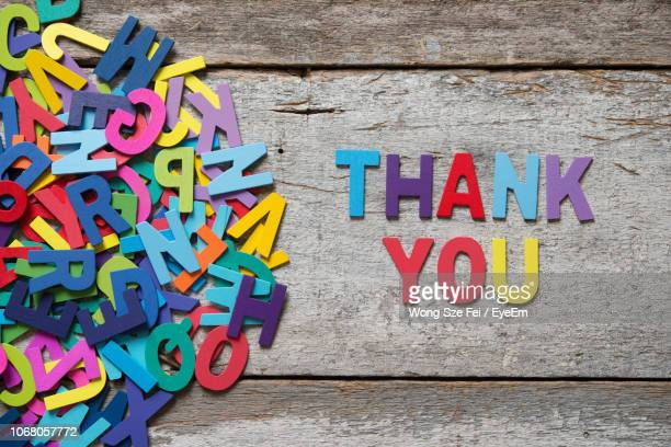 directly above shot of colorful text on wooden table - thank you stock pictures, royalty-free photos & images