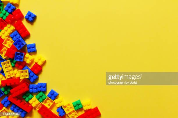 directly above shot of colorful toy blocks - leisure games stock pictures, royalty-free photos & images