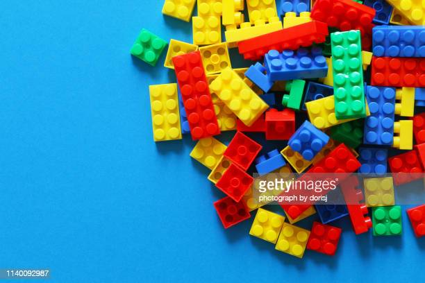 directly above shot of colorful toy blocks - toy block stock pictures, royalty-free photos & images