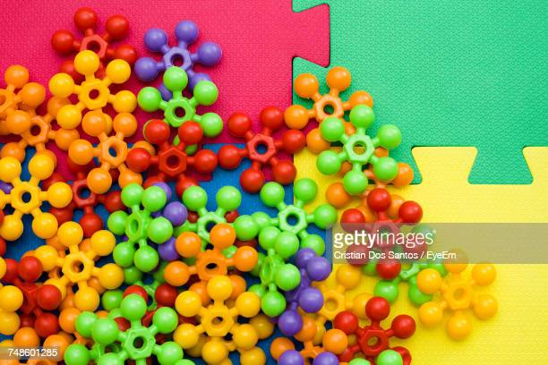 Directly Above Shot Of Colorful Toys On Puzzle