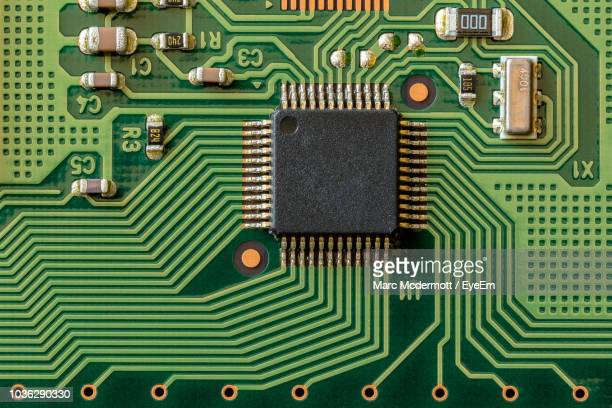 directly above shot of computer chip - computer chip stock pictures, royalty-free photos & images