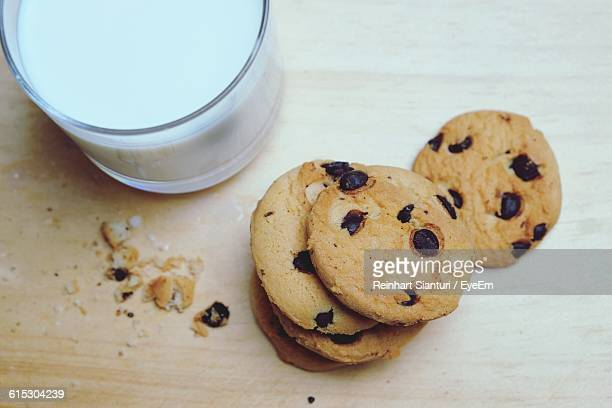 Directly Above Shot Of Cookies And Milk Glass On Table