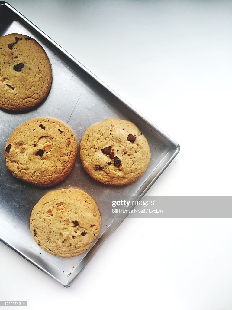 Directly Above Shot Of Cookies In Baking Sheet On White Background : Stock Photo