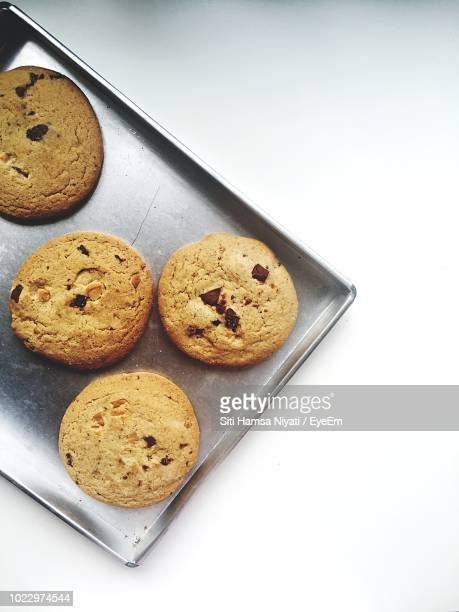 Directly Above Shot Of Cookies In Baking Sheet On White Background