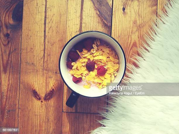 Directly Above Shot Of Corn Flake Cereal With Raspberries