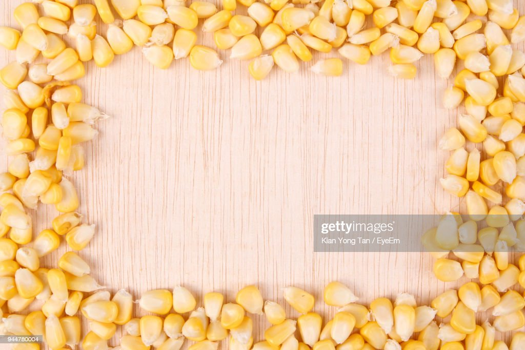 Directly Above Shot Of Corns Arranged On Table : Stock Photo