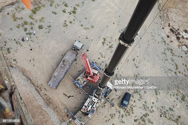 Directly Above Shot Of Crane By Vehicles At Construction Site