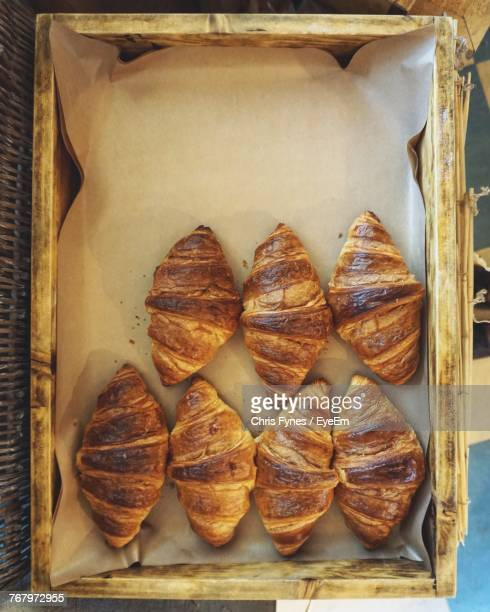 directly above shot of croissants in container - croissant stock pictures, royalty-free photos & images