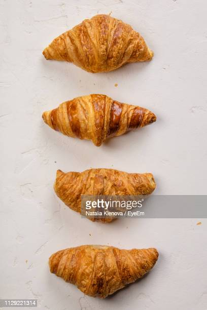 directly above shot of croissants on table - croissant stock pictures, royalty-free photos & images
