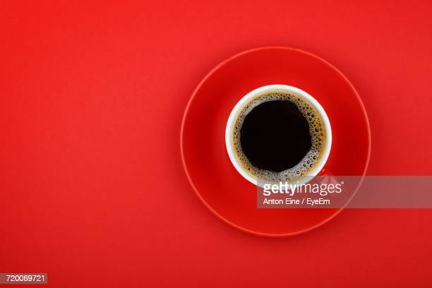 Directly Above Shot Of Cup Against Red Background