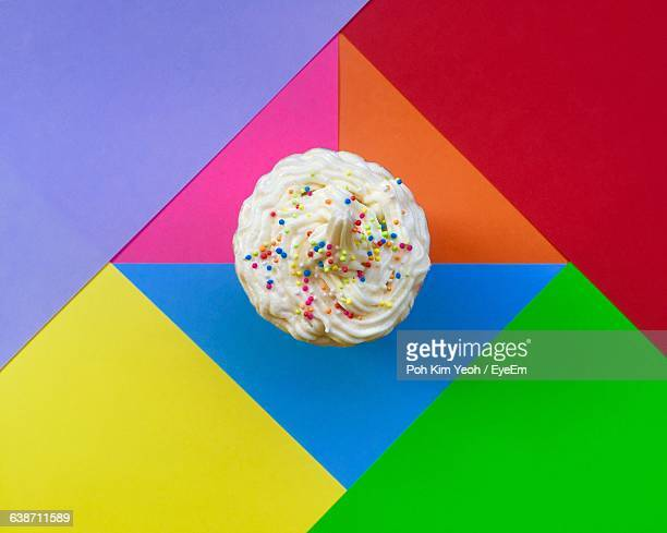 Directly Above Shot Of Cupcake On Colorful Background