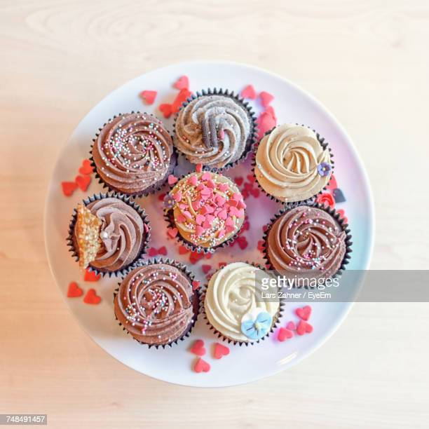 Directly Above Shot Of Cupcakes In Plate On Table