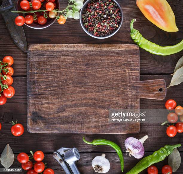 directly above shot of cutting board amidst various ingredients on table - cutting board stock pictures, royalty-free photos & images