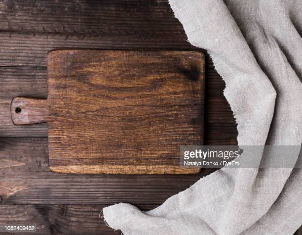 Directly Above Shot Of Cutting Board By Napkin On Table