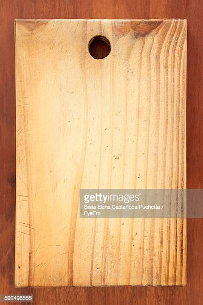 directly above shot of cutting board on wooden table - cutting board stock pictures, royalty-free photos & images
