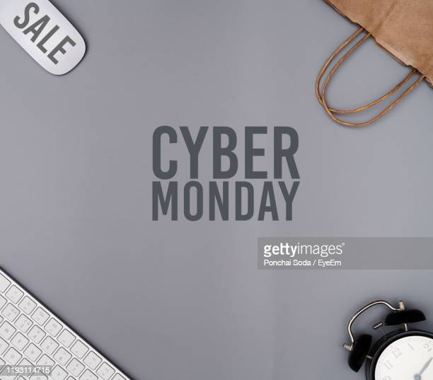 directly above shot of cyber monday text on table - cyber monday stock pictures, royalty-free photos & images