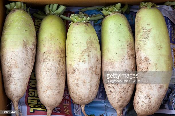 Directly Above Shot Of Daikon Radish For Sale At Market Stall