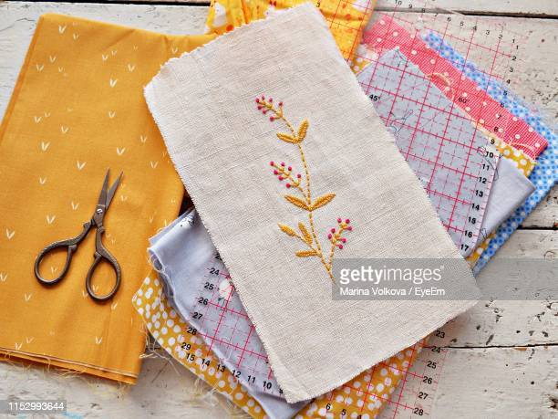 directly above shot of decorated fabrics on table - embroidery stock pictures, royalty-free photos & images