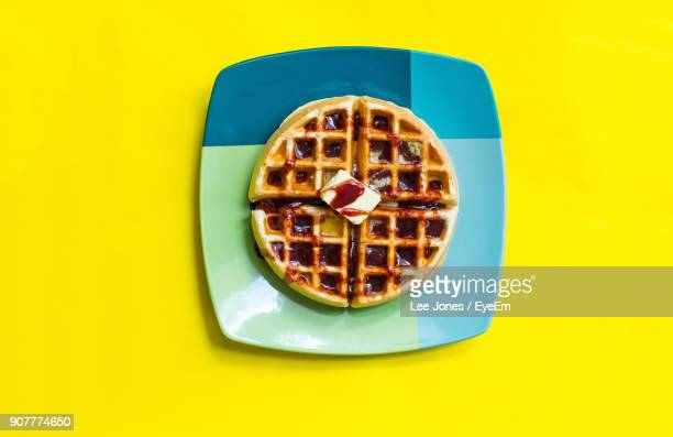 directly above shot of dessert in plate on yellow background - waffle stock photos and pictures