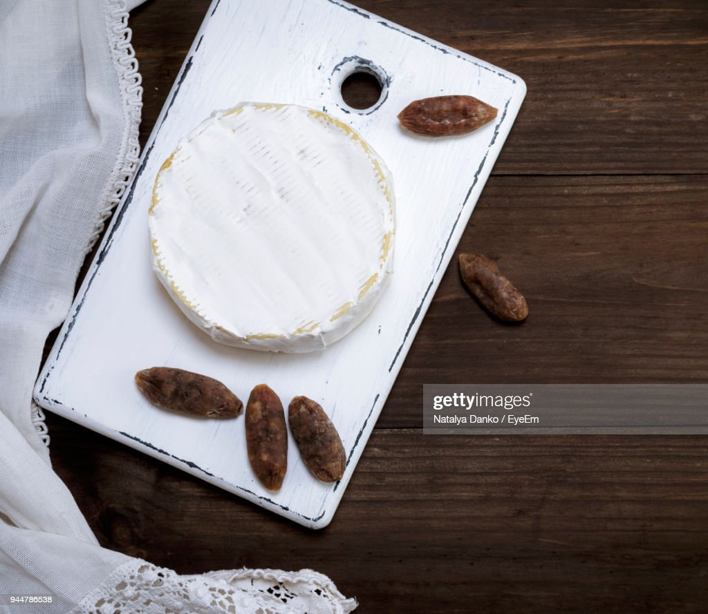 Directly Above Shot Of Dessert With Dried Fruits On Table : Stock Photo