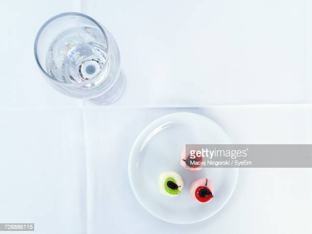Directly Above Shot Of Dessert With Wineglass On White Table At Restaurant
