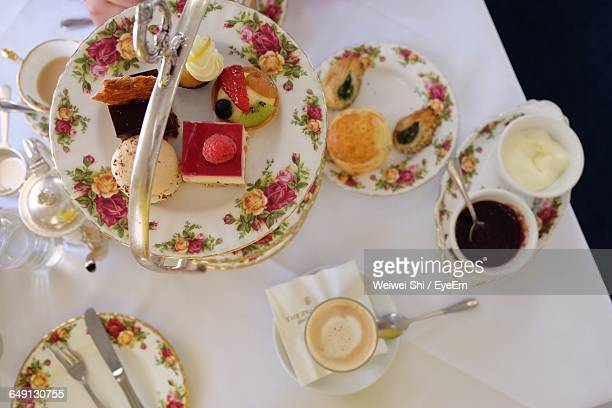 Directly Above Shot Of Desserts In Plates On Table