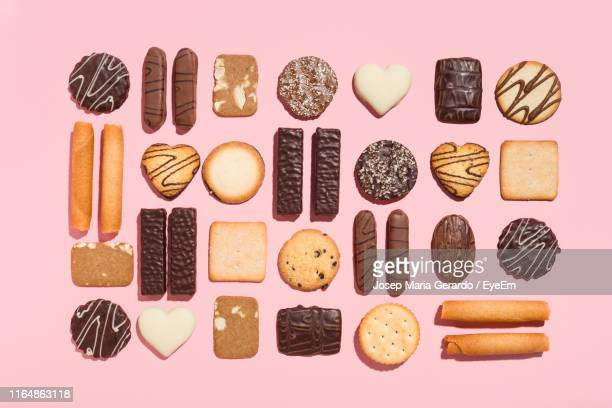 directly above shot of desserts on pink background - cookie stock pictures, royalty-free photos & images