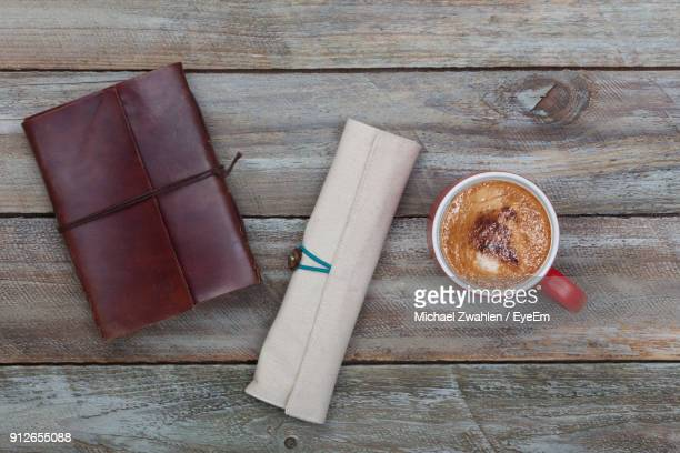 directly above shot of diary with pencil case and coffee cup on table - pencil case stock photos and pictures