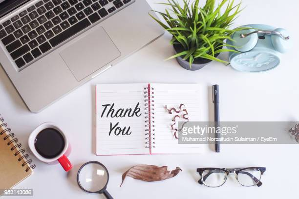 directly above shot of diary with thank you text by various objects on table - thank you stock pictures, royalty-free photos & images