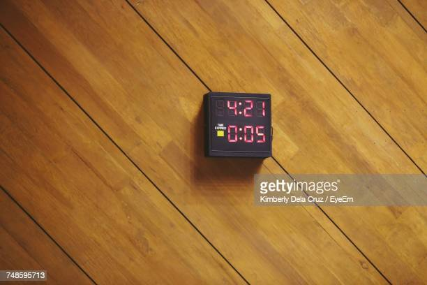 directly above shot of digital clock on floorboard - floorboard stock photos and pictures