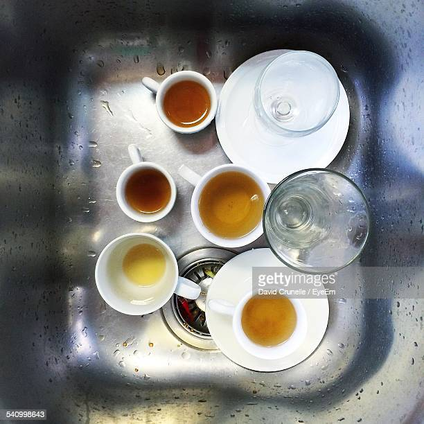 Directly Above Shot Of Dirty Cups And Saucer In Kitchen Sink