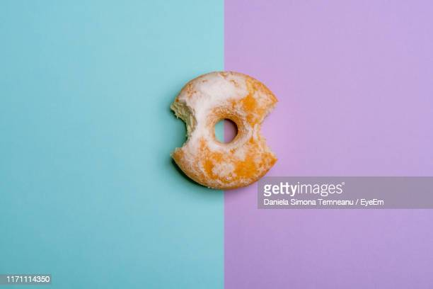 directly above shot of donut on colored background - ツートンカラー ストックフォトと画像