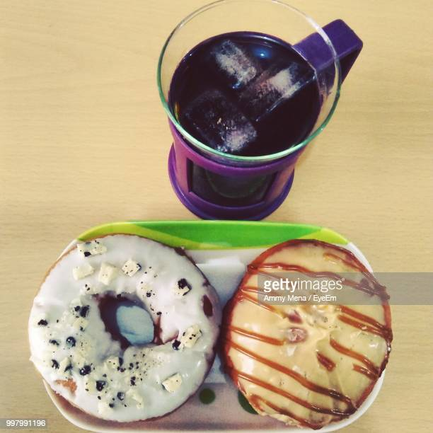 directly above shot of donuts and drink on table - ammy stock pictures, royalty-free photos & images